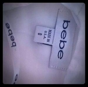 Bebe Sleeveless Cream Colored Top